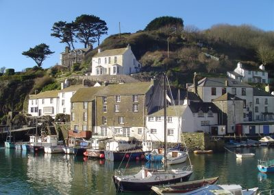 very large polperro harbour and boats